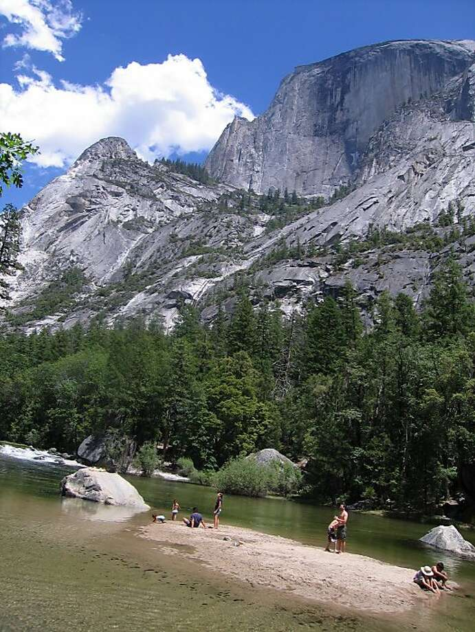 Swimmers at Mirror Lake in Yosemite with Ahwiyah Point, left, and Half Dome, right,  in background. Photo: Beth Kohn, Special To The Chronicle