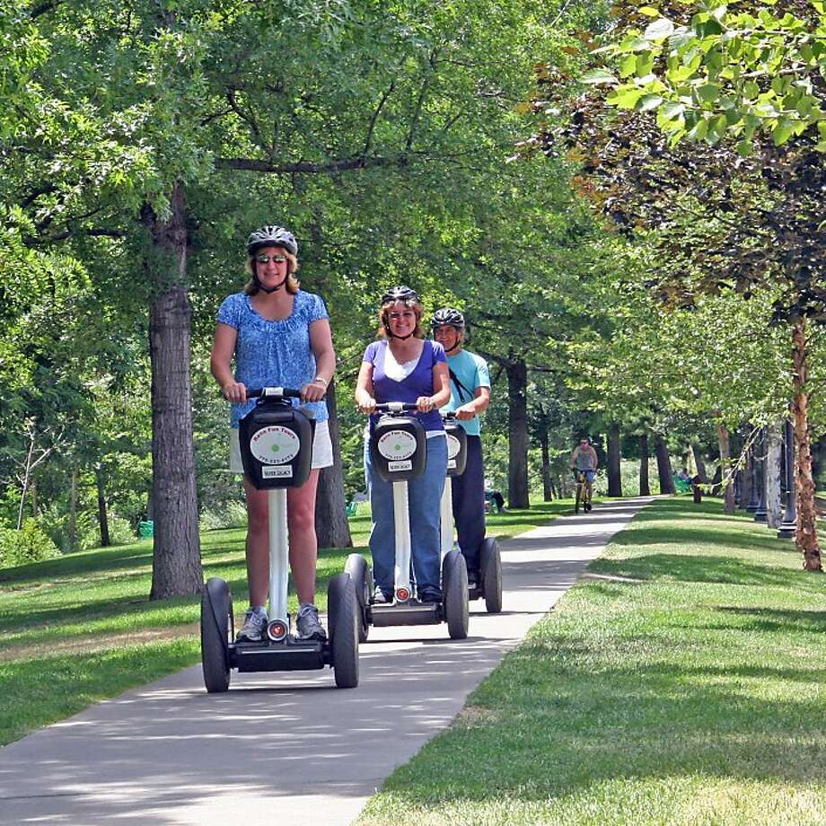 Cinda Heron, co-owner of Reno Tun Tours, leads visitors along the walkway next to the Truckee River. Photo: Mark S. Bacon