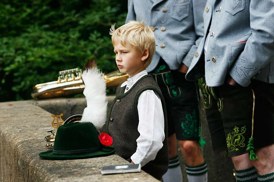 STARNBERG, GERMANY - JUNE 13:  A boy wearing a traditional Bavarian costume attends a religious mass to be held in honour of the 125th anniversary of the death of Bavarian King Ludwig II in at the shore of Starnberger See lake on June 13, 2011 in Berg, Germany. Hundreds of people  participated in the event to commemorate Ludwig, who was also known as Fairytale King Ludwig for his eccentricities that included the construction of elaborate palaces and castles, most notably Schloss Neuschwanstein. Ludwig drowned in Starnberger See in 1886. The state of Bavaria is marking the anniversary of his death with a series of events throughout the year.  (Photo by Alexandra Beier/Getty Images) Photo: Alexandra Beier, Getty Images