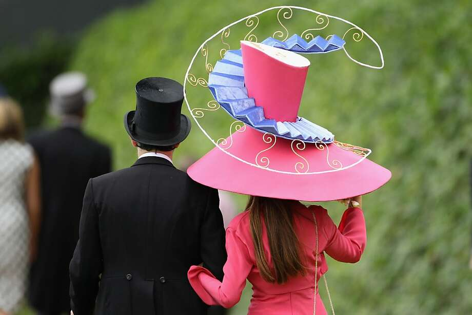 Racegoers walk by the racecourse on Ladies Day at Royal Ascot on June 16, 2011 in Ascot, England. The five-day meeting is one of the highlights of the horse racing calendar, with 2011 marking the 300th anniversary of the annual event. Horse racing has been held at the famous Berkshire course since 1711. Photo: Dan Kitwood, Getty Images