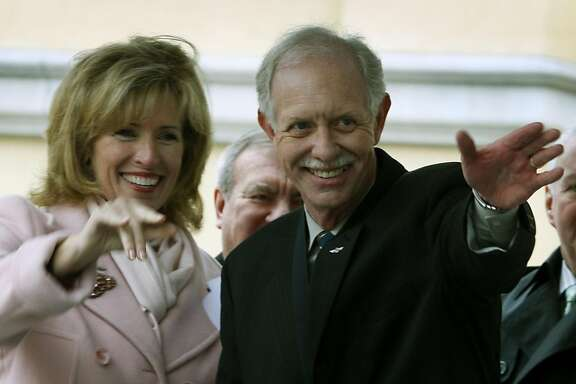 "US Airways Captain Chesley ""Sully"" Sullenberger III and is wife Lorrie  Sullenberger greet friends in the audience during a ceremony honoring the Captain outside Danville Calif Library Saturday Jan 24, 2009"