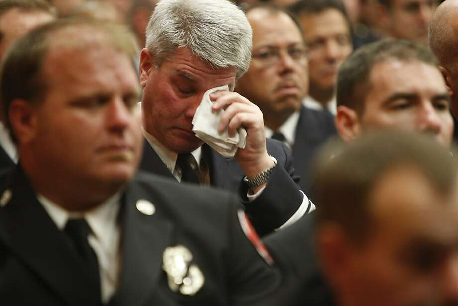 A firefighter becomes emotional as he hears remembrances of Lt. Vincent Perez and firefighter/paramedic Anthony Valerio of the San Francisco Fire Department by friends and family.  The funeral was held in San Francisco Calif., on June 10, 2011. Photo: Audrey Whitmeyer-Weathers, The Chronicle