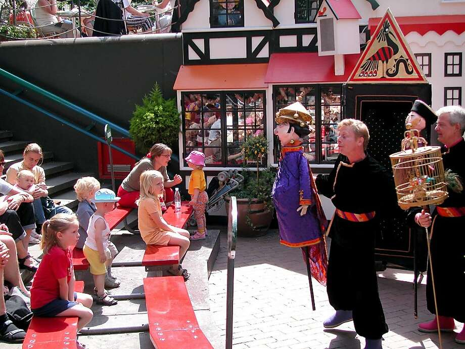 At Tivoli Gardens in Copenhagen, kids will be entertained by the puppet shows, acrobats, and pantomime theater that pop up all over the park. Photo: Rick Steves