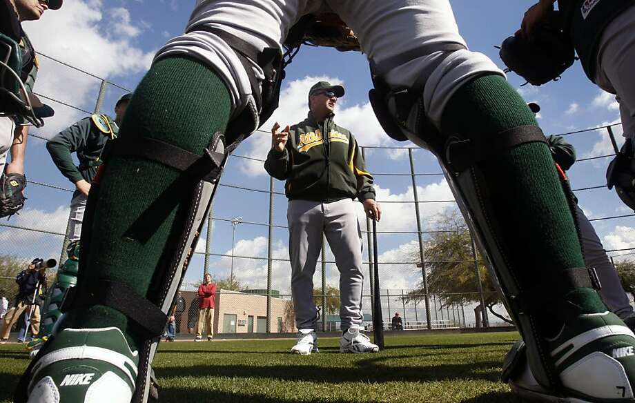 Oakland Athletics Manager Bob Geren talks with the catchers during Spring Training workouts at the Papago Baseball Complex Tuesday February 17, 2009 in Phoenix Arizona. Photo: Lance Iversen, The Chronicle