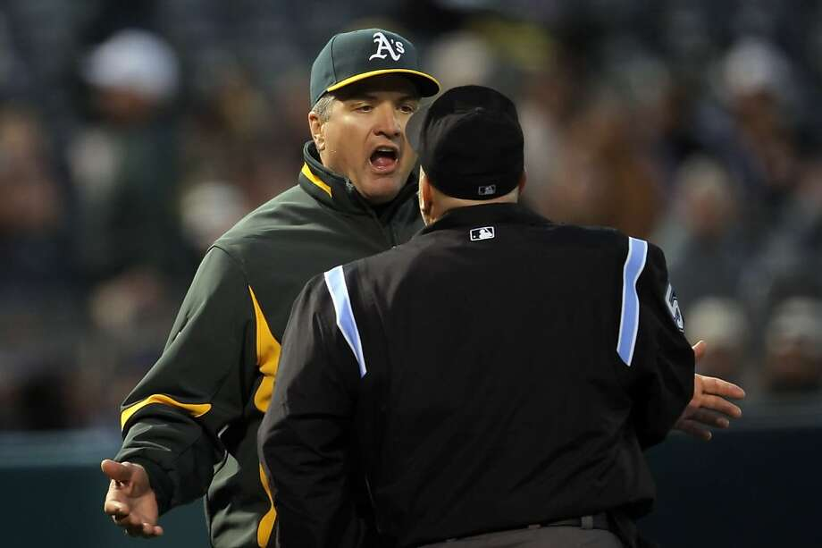 FILE - A's manager Bob Geren argues with homeplate umpire Eric Cooper, facing away from the camera, after Cooper ejected batting coach Jim Skaalen for arguing balls and strikes in the sixth inning. The Oakland Athletics played the Los Angeles Angeles of Anaheim on Monday, June 7, 2010, at the Oakland-Alameda County Coliseum in Oakland, Calif. Geren is reportedly being looked at Giants manager Bruce Bochy, whose last game is this Sunday. Photo: Carlos Avila Gonzalez, The Chronicle