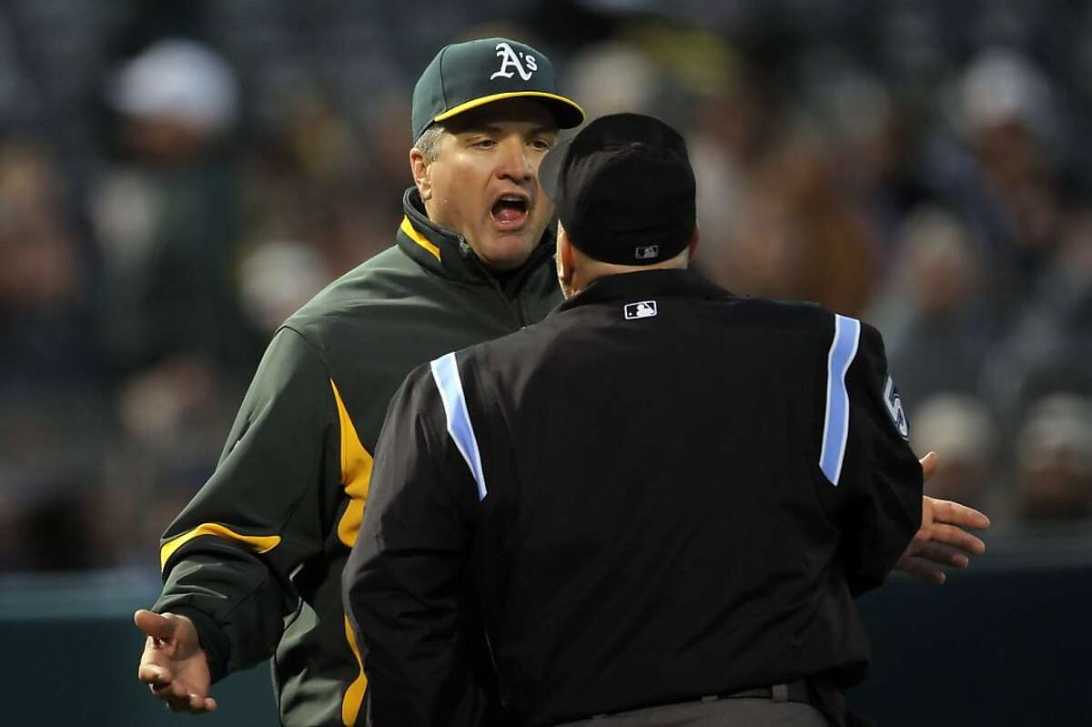 FILE - A's manager Bob Geren argues with homeplate umpire Eric Cooper, facing away from the camera, after Cooper ejected batting coach Jim Skaalen for arguing balls and strikes in the sixth inning. The Oakland Athletics played the Los Angeles Angeles of Anaheim on Monday, June 7, 2010, at the Oakland-Alameda County Coliseum in Oakland, Calif. Geren is reportedly being looked at Giants manager Bruce Bochy, whose last game is this Sunday.