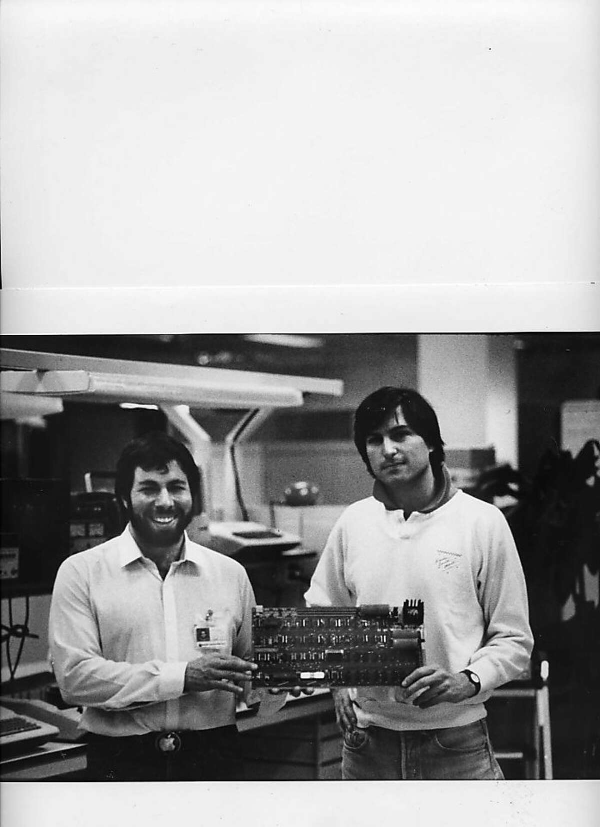 Steve Wozniak and Steve Jobs, Co-Founder of the Apple Computer with one of the original Apple I computer circuit boards.