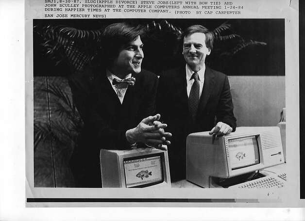 Steve Jobs (left) with bow tie and John Sculley at the Apple Computers annual meeting on January 24, 1984. Photo: Cap Carpenter, AP