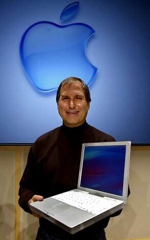 Apple computers inc chief executive officer steve jobs holds up the