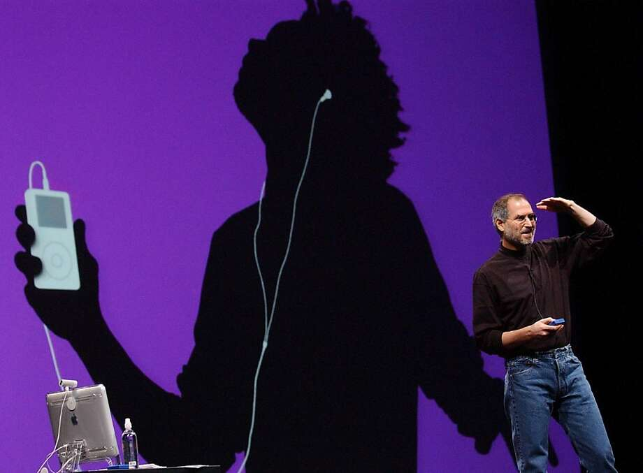 Apple's eye-catching silhouette ads for iPods were all the craze in the 2000s. Photo: Marcio Jose Sanchez, AP