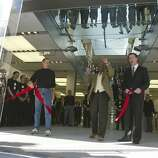 Apple CEO and co founder Steve Jobs and former San Francisco mayor Willie Brown and current mayor Gavin Newsom cut the ceremonial ribbon opening Apple Computer's flagship store in downtown San Francisco on February 28, 2004.