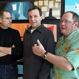 Walt Disney Co. CEO Robert Iger, center, talks with Pixar Animation Studios Inc. CEO Steve Jobs, left, and Pixar Executive Vice President John Lasseter at Pixar headquarters in Emeryville, Calif., Jan. 24, 2006, after Disney announced it is buying longtime partner Pixar.  Just four months on the job, Iger's vision for Disney's future includes an aggressive embrace of technology that will let Disney content reach consumers via various platforms.