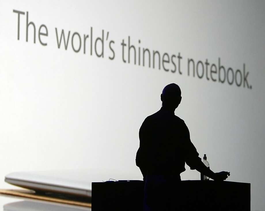 Apple CEO Steve Jobs watches an advertisement for the MacBook Air during his keynote address to open the annual Macworld conference in San Francisco, Calif. on Tuesday, Jan. 15, 2008. Jobs announced upgrades to the iPhone and iTouch and introduced the new MacBook Air and Time Capsule. Photo: Paul Chinn, The Chronicle