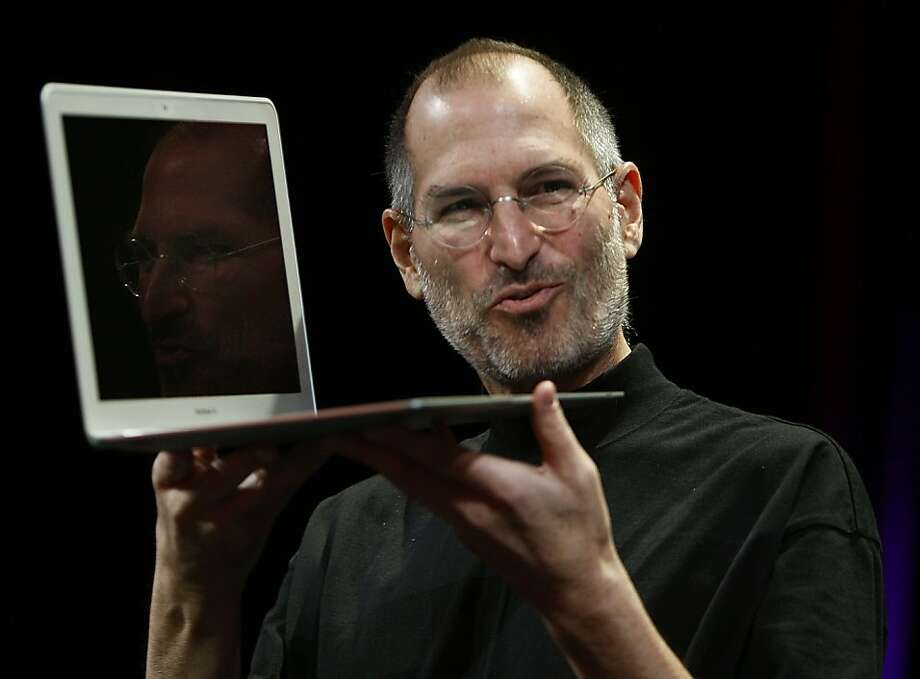 Apple CEO Steve Jobs shows off the ultra-thin MacBook Air during his keynote address to open the annual Macworld conference in San Francisco, Calif. on Tuesday, Jan. 15, 2008. Jobs announced upgrades to the iPhone and iTouch and introduced the new MacBook Air and Time Capsule. Photo: Paul Chinn, The Chronicle