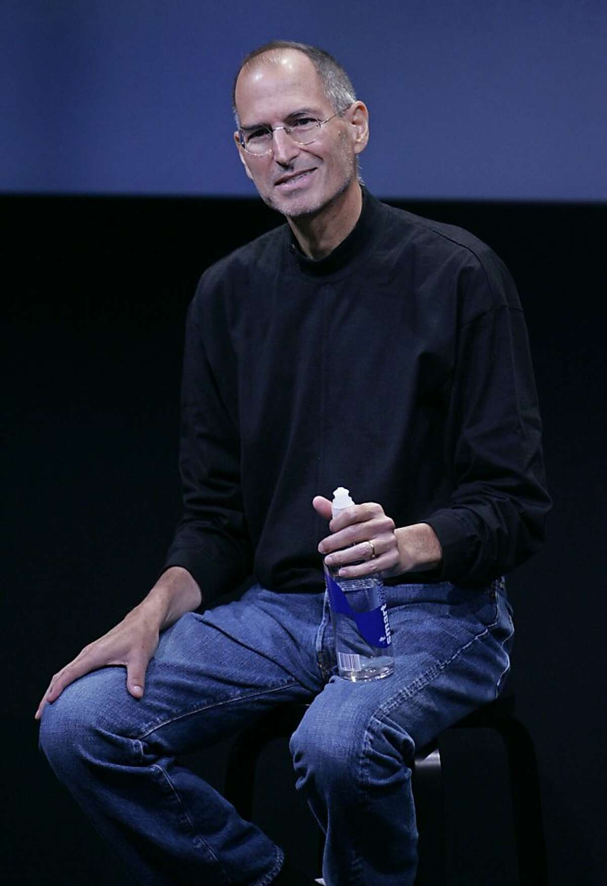 In this Oct. 14, 2008 file photo, Apple Inc. CEO Steve Jobs smiles during a product announcement at Apple headquarters in Cupertino, Calif. A published report says Jobs, who has been on medical leave for undisclosed reasons since January, received a liver transplant two months ago, Saturday, June 20, 2009.