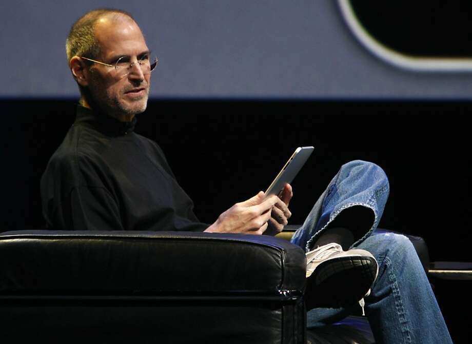 Apple CEO Steve Jobs demonstrates the iPad tablet for invited guests at the Yerba Buena Center for the Arts in San Francisco, Calif., on Wednesday, Jan. 27, 2010. Photo: Paul Chinn, The Chronicle