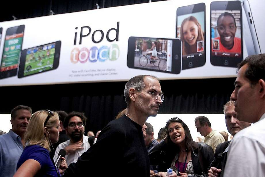 Steve Jobs, chief executive officer of Apple Inc., center, speaks to members of the media during an Apple product unveiling event in San Francisco, California, U.S., on Wednesday, Sept. 1, 2010. Apple, building on its dominance in the music industry, introduced new iPods, added a social networking feature to its iTunes software, and unveiled a new Apple TV set-top box that offers television and movie rentals. Photo: David Paul Morris, Bloomberg
