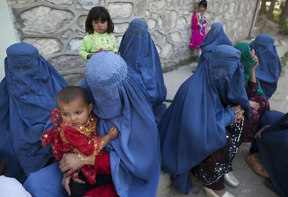 FAIZABAD,  AFGHANISTAN -JUNE 2 :  Afghan women and children  wait outside the Badakshan Provincial hospital to be seen June 2, 2011, in Faizabad, Badakshan.  According to UNICEF,  52 babies out of every 1,000 die within two weeks of birth and 134 die before their first birthday. While 1 in 8 women in Afghanistan die during pregnancy or childbirth making it the worst place in the world to be a mother. Many mothers are having children too young along with diet, and extreme poverty they face huge challengeshaving a healthy pregnancy.  Afghan women also deal with vitamin D deficiency from staying indoors and being covered up. In the rural parts of the country, in remote areas Afghan women deliver with no skilled help because women cannot leave home without Photo: Paula Bronstein, Getty Images