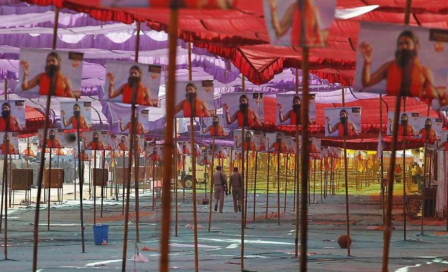 Policemen walk inside an empty yoga camp being hosted by Ramdev after police cleared the camp in New Delhi, India  Sunday, June 5, 2011. Police officers swooped down Sunday on the venue of a hunger strike by the charismatic Indian yoga guru and forcibly removed him and thousands of his supporters. Photo: Saurabh Das, AP