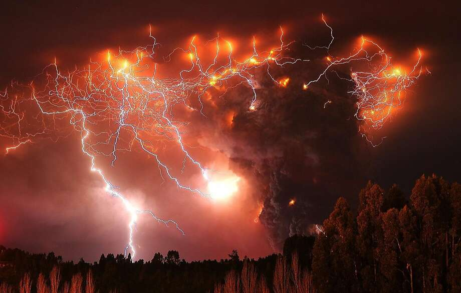 Lightning strikes over the Puyehue volcano, over 500 miles south of Santiago, Chile, Monday June 6, 2011.  Authorities have evacuated about 3,500 people in the nearby area. The volcano was calm on Monday, two days after raining down ash and forcing thousands to flee, although the cloud of soot it had belched out still darkened skies as far away as Argentina. Photo: Francisco Negroni, AgenciaUno
