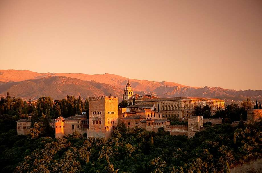 Glowing at sunset, Granada's Alhambra is a showcase for the arts and architecture of Moorish civilization. Photo: Dominic Bonuccelli