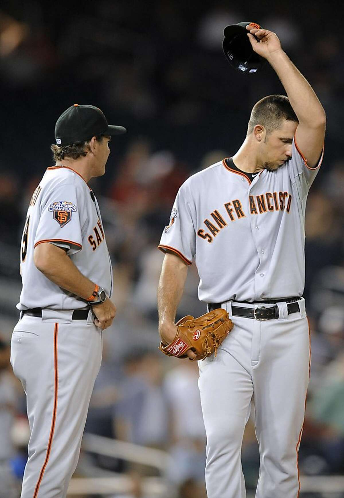 San Francisco Giants pitching coach Dave Righetti, left, visits starting pitcher Madison Bumgarner during the seventh inning of a baseball game against the Washington Nationals on Monday, May 2, 2011, in Washington. The Nationals won 2-0.