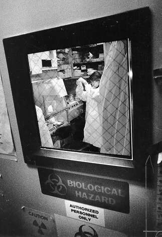 January 26th, 1989 - UCSF AIDS Immunobiology Research Institute. Isabelle Gaston, research assistant working on blood isolation within the Bio Hazards Facility. Photo: Eric Luse, The Chronicle