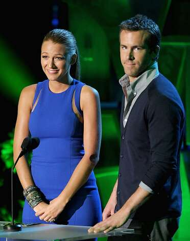 UNIVERSAL CITY, CA - JUNE 05:  Actors Blake Lively (L) and Ryan Reynolds speak onstage during the 2011 MTV Movie Awards at Universal Studios' Gibson Amphitheatre on June 5, 2011 in Universal City, California. Photo: Kevin Winter, Getty Images