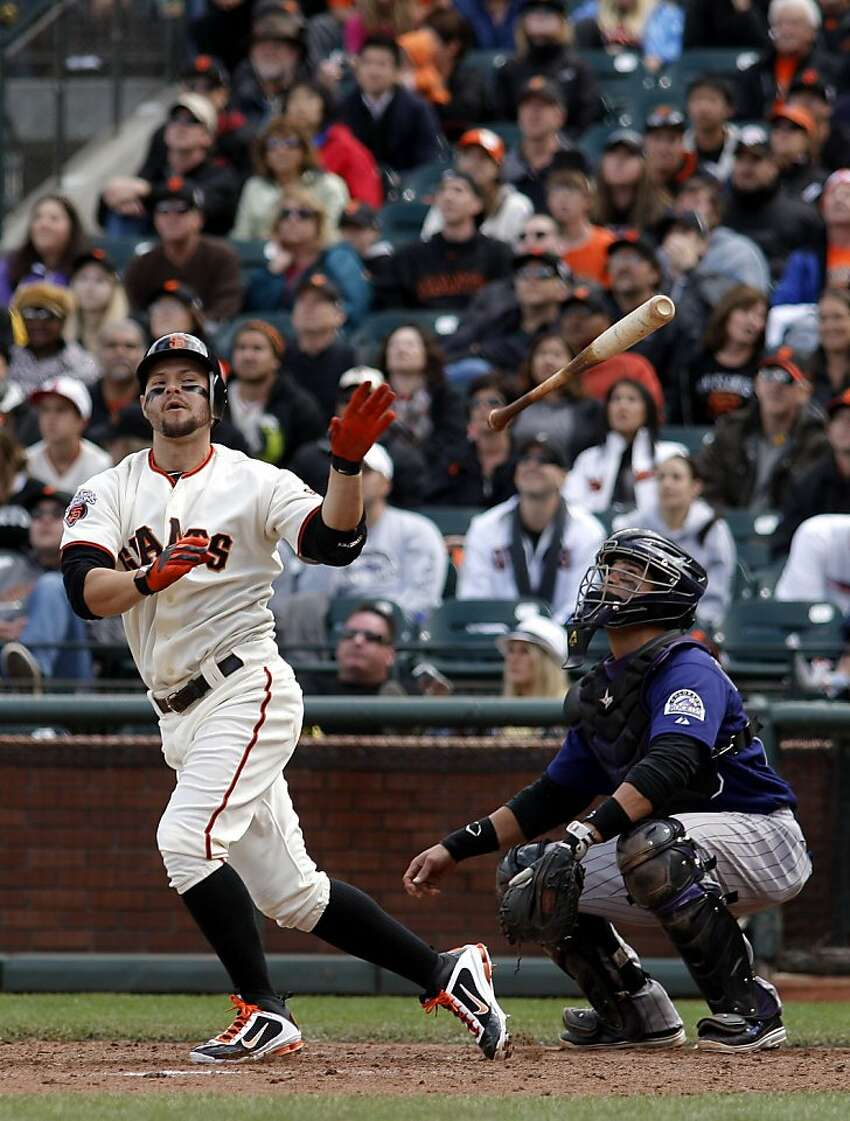 The Giants' Cody Ross tosses his bat after his pop fly out in the ninth inning against the Colorado Rockies at AT&T Park in San Francisco on Saturday.