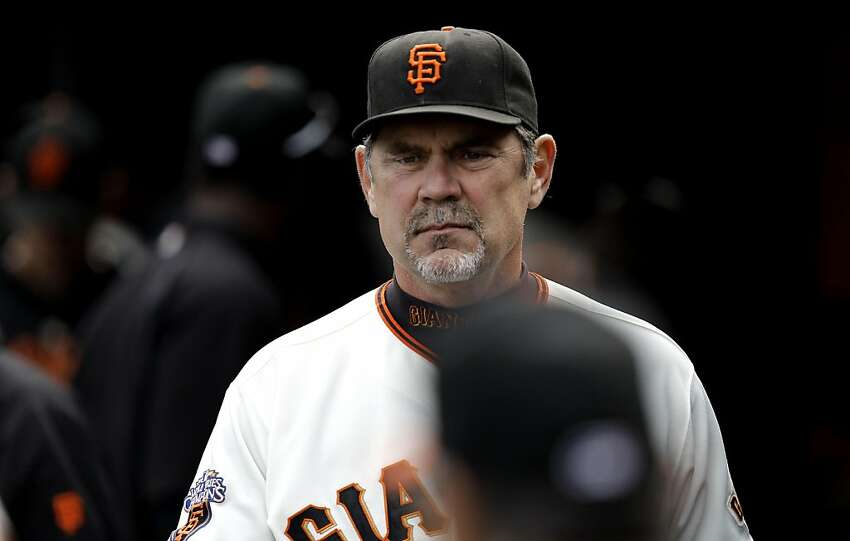 Giants manager Bruce Bochy heads to the locker room as the San Francisco Giants fall to the Colorado Rockies at AT&T Park in San Francisco on Saturday.