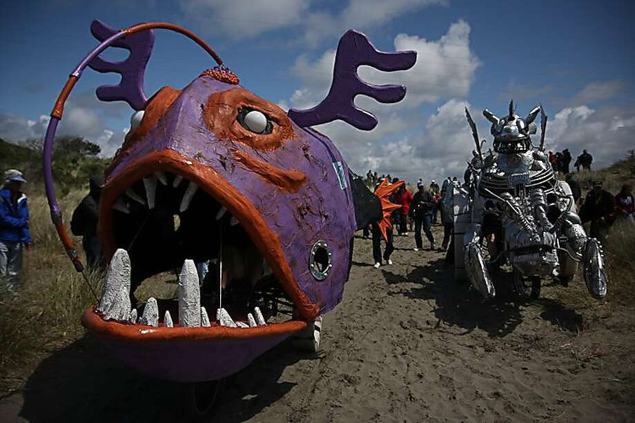 The 43rd Annual Kinetic Grand Championship took place over Memorial Day weekend where about 40 teams took on the three-day course over land, sand, mud and water.  Here Mr. Fish (left) passes Bottom Feeders while heading out to the beach. Photo: Josh Keppel, Special To SFGate