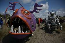 The 43rd Annual Kinetic Grand Championship took place over Memorial Day weekend where about 40 teams took on the three-day course over land, sand, mud and water.  Here Mr. Fish (left) passes Bottom Feeders while heading out to the beach.