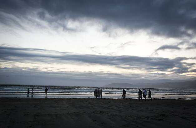 Despite the a stiff wind, people gathered at Pismo Beach to watch the sun set on Saturday, May 28th, 2011. Photo: Ali Thanawalla, SFGate