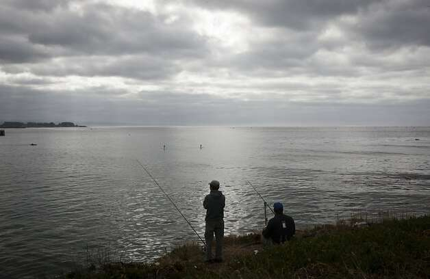 All along West Cliff Drive in Santa Cruz, people were fishing from high up on the cliffs. Photo: Ali Thanawalla, SFGate