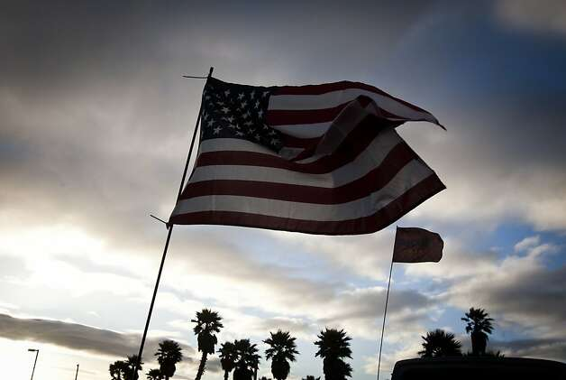 An American flag waves in the wind at Pismo Beach on the evening of Saturday, May 28th, 2011. Photo: Ali Thanawalla, SFGate