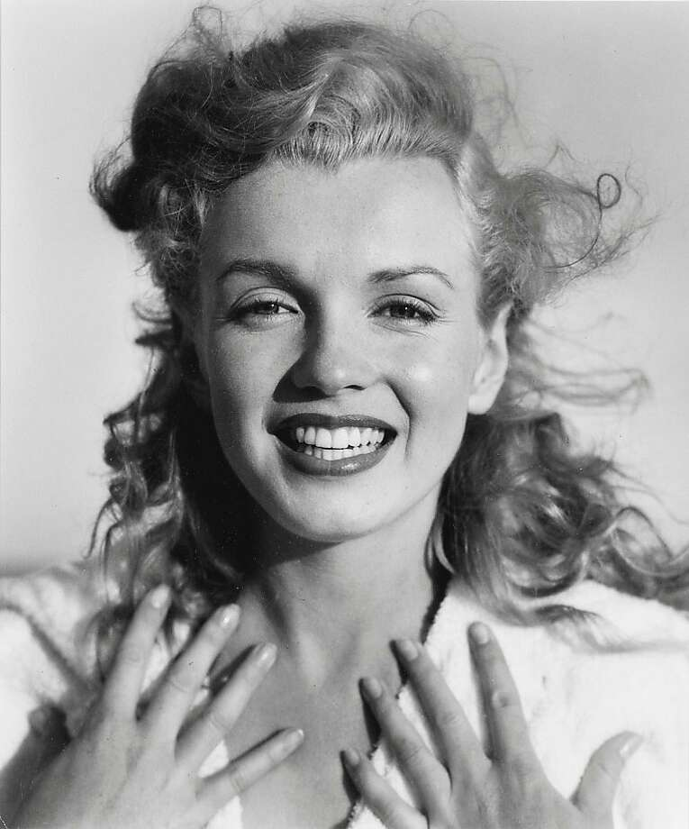 In this photo released by Christie's auction house, actress Marilyn Monroe is photographed on a Long Island, N.Y. beach by photographer Andre De Dienes in 1949. The photo is among more than 100 Monroe images being offered for sale in three sessions on Dec. 16-17 at Christie's auction house. They are expected to bring from $811,000 to $1.1 million.(AP Photo/Christie's, Andre De Dienes)**NO SALES** Photo: Andre De Dienes, AP