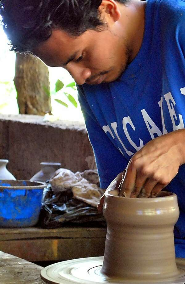 Following centuries of tradition, a teenage Nicaraguan uses a foot-powered potter's wheel to form a clay pot. Photo: Rick Steves