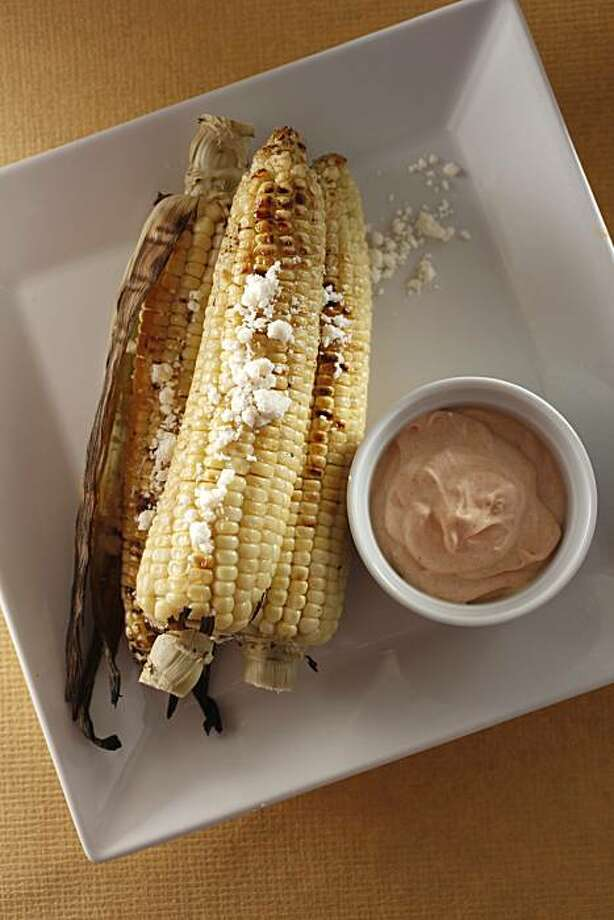 Grilled Corn On The Cob With Spicy Lime Creme Fraiche & Cotija Cheese: This is a take on the traditional Mexican street food. Click here for the recipe. Photo: Craig Lee, Special To The Chronicle