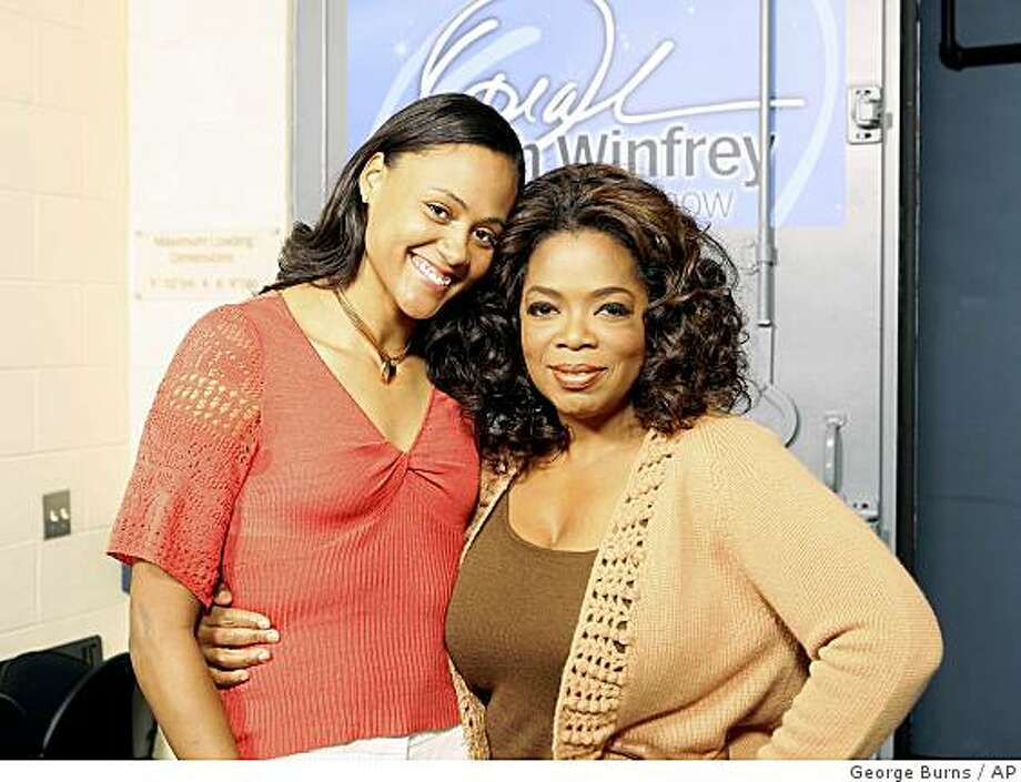 "In this photo released by Harpo Productions, Inc.,  former Olympic medalist Marion Jones, left, is shown with talk-show host Oprah Winfrey during taping of the ""The Oprah Winfrey Show,"" in Chicago on Oct. 24, 2008. Photo: George Burns, AP"