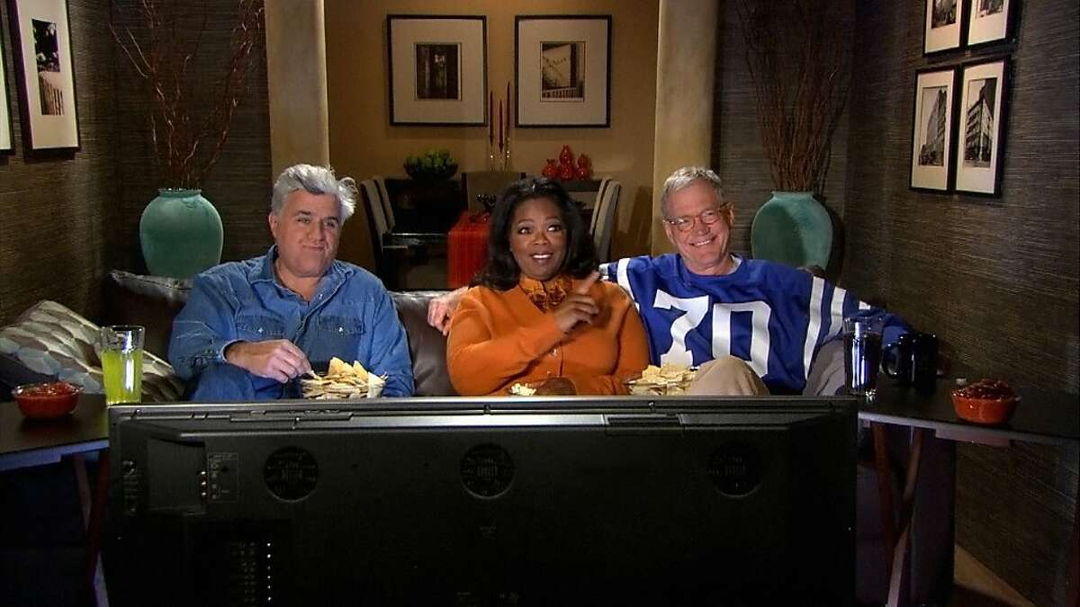 In an image from video provided by CBS, David Letterman, Oprah Winfrey and Jay Leno, from right, record a promo for CBS'
