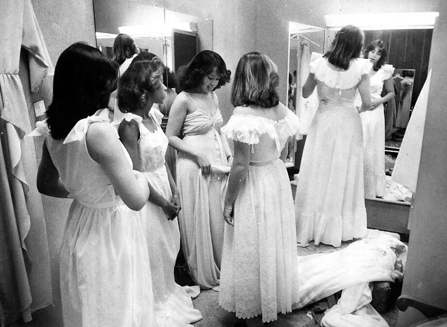 Christina Pyun, Phyllis Williams, Dee Dee Williams, Valerie Brock and Susie Rosenthal (looking in mirror) try on prom dresses. Photo ran on May 18, 1981.Christina Pyun, Phyllis Williams, Dee Dee Williams, Valerie Brock and Susie Rosenthal (looking in mirror) try on prom dresses. Photo taken on May 18, 1981. Photo: Frederic Larson, The Chronicle