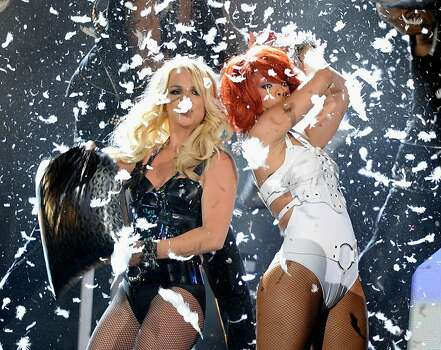 LAS VEGAS, NV - MAY 22:  Singers Britney Spears (L) and Rihanna perform onstage during the 2011 Billboard Music Awards at the MGM Grand Garden Arena May 22, 2011 in Las Vegas, Nevada.  (Photo by Ethan Miller/Getty Images for ABC) Photo: Ethan Miller, Getty Images For ABC