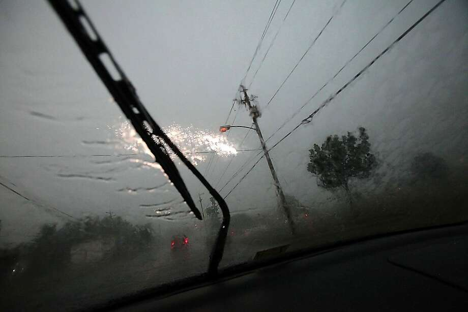 In a May 24, 2011 photo, electric wires shoot sparks into the air as lighting strikes nearby when heavy storm clouds move into the Hampton Roads area Tuesday afternoon in Norfolk, Va. Heavy rain with gusty wind and hail caused much damages throughout thearea. Photo: Hyunsoo Leo Kim, The Virginian-Pilot