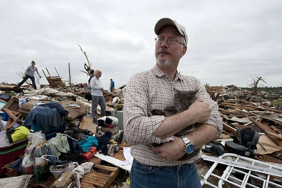 JOPLIN, MO - MAY 24:   While searching through the rubble of his home, David Vanderhoofven was reunited with his cat Harley on May 24, 2011 in Joplin, Missouri.   Vanderhoofven lost his wife Darian Vanderhoofven and son Joshua in the tornado Sunday.  Thetornado that ripped through the town of about 50,000 people May 22, is being called the deadliest single tornado in the U.S. in 60 years. Photo: Julie Denesha, Getty Images