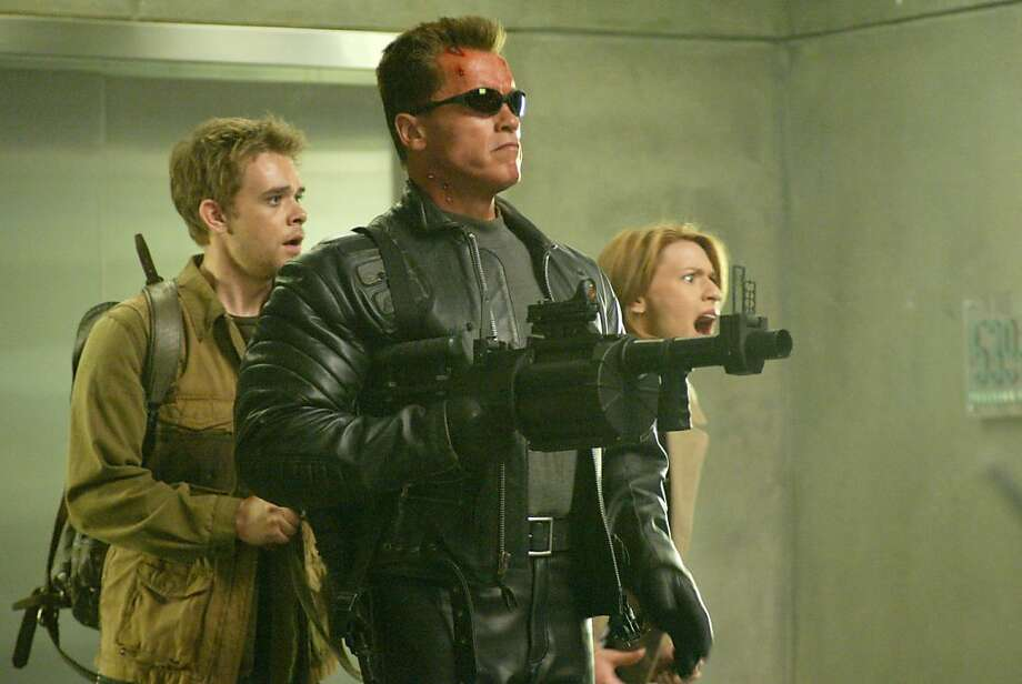 "Nick Stahl, Arnold Schwarzenegger and Claire Danes are shown in a scene from ""Terminator 3: Rise of the Machines."" Photo: Warner Bros. Pictures"
