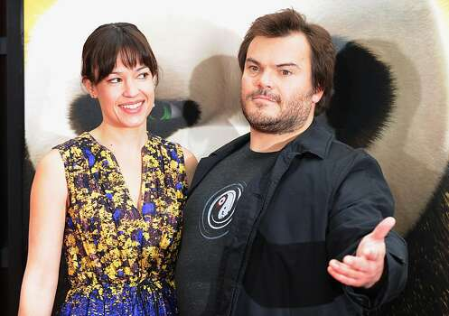 "Actor Jack Black and wife singer Tanya Haden arrive on the red carpet for the Los Angeles premiere Of DreamWorks Animation's ""Kung Fu Panda 2"" at Grauman's Chinese Theatre in Hollywood, California. on May 22, 2011. Photo: Mark Ralston, AFP/Getty Images"