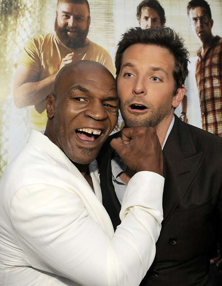 "Mike Tyson, left, and Bradley Cooper, cast members in ""The Hangover Part II,"" pose together at the premiere of the film, Thursday, May 19, 2011, in Los Angeles. Photo: Chris Pizzello, AP"