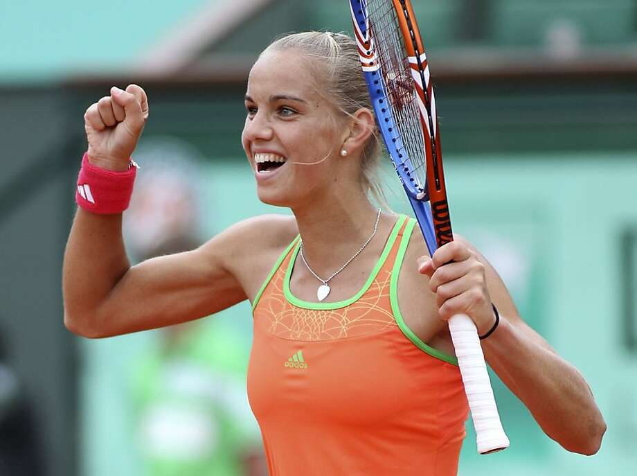 The Netherlands' Aranxta Rus celebrates her victory over Belgium's Kim Clijsters during their second round match of the French Open tennis tournament, at  the Roland Garros stadium in Paris, Thursday, May 26, 2011. Photo: Michel Euler, AP