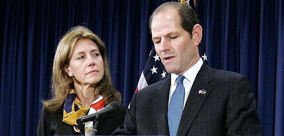 New York State Gov. Eliot Spitzer announces his resignation amid a prostitution scandal as wife Silda looks on Wednesday, March 12, 2008 in his offices in New York City.(AP Photo/Stephen Chernin) Photo: Stephen Chernin, AP