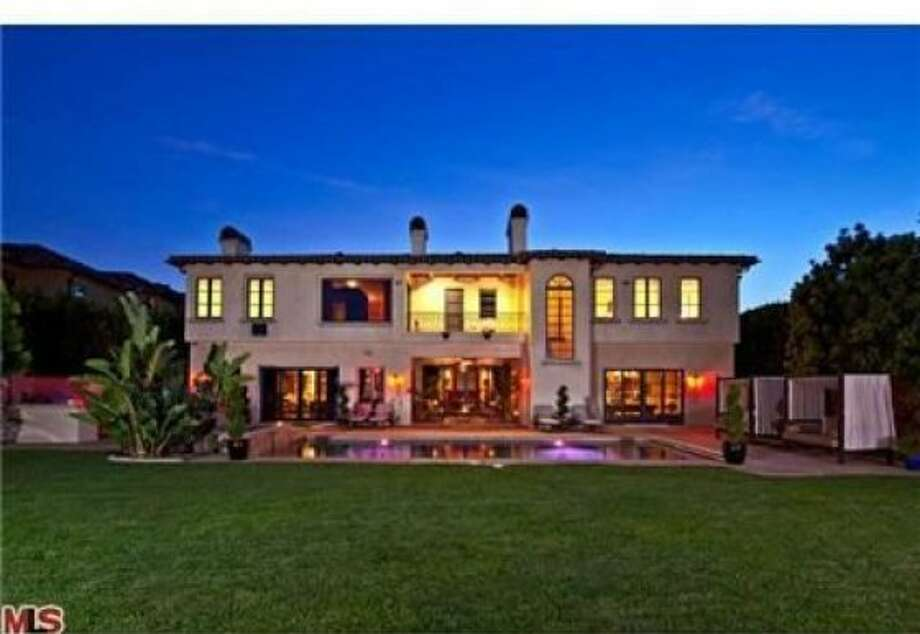 An external view of the rear of the property at night. Photo: Coldwell Banker